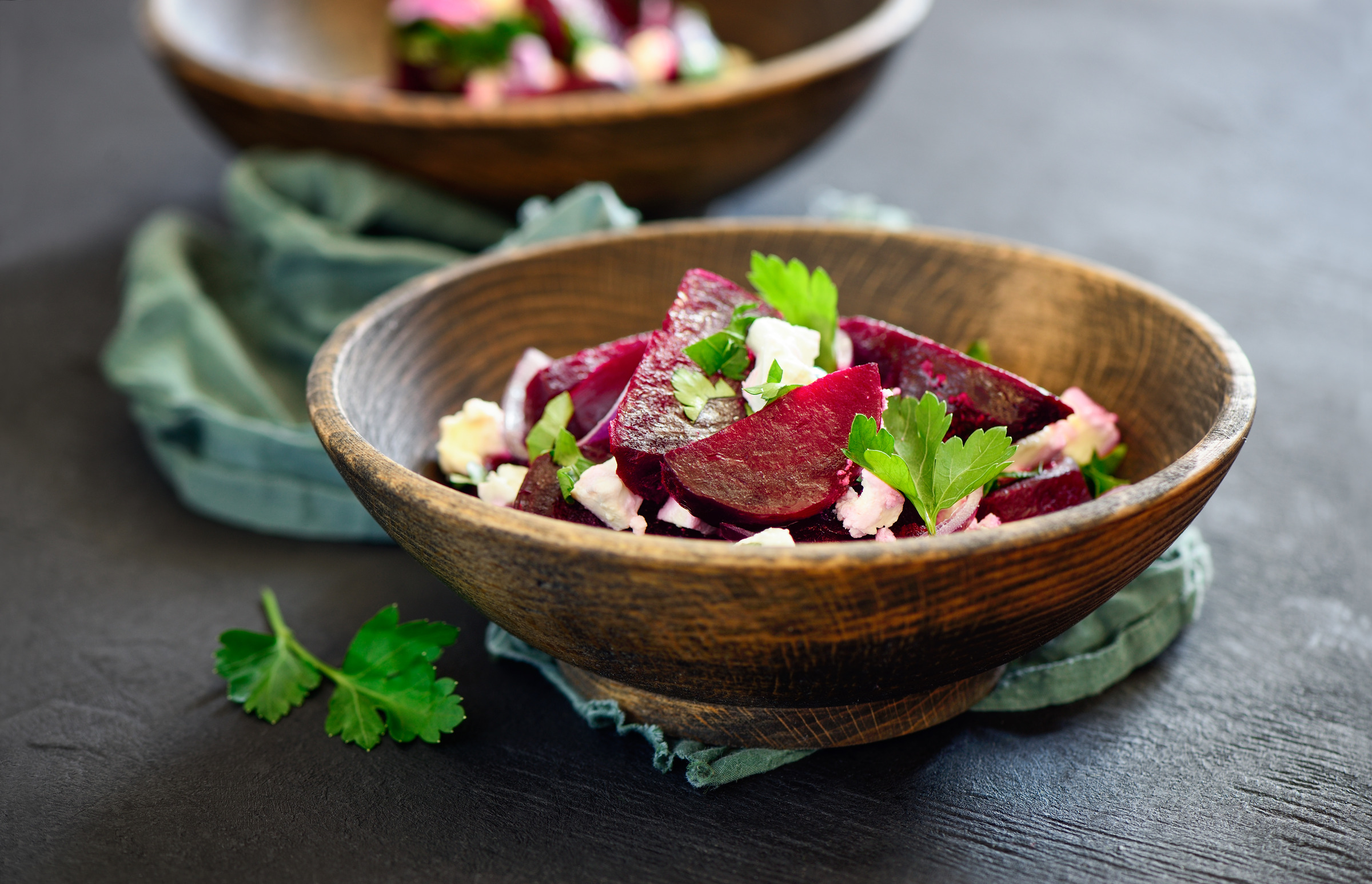 Beetroot and feta salad on a dark wooden table